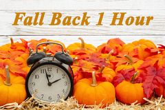 Free Fall Back 1 Hour Time Change Message With A Retro Alarm Clock With Pumpkins And Fall Leaves Stock Photo - 161790950