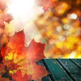 Fall Background with Autumn Leaves, Empty Wooden Table Royalty Free Stock Photography