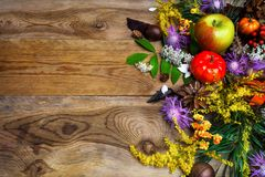 Fall greeting with yellow autumn flowers on wooden table Royalty Free Stock Photo