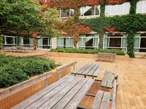 Fall benches and tables Aarhus University, Denmark stock photography