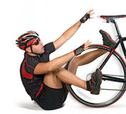 Fall from bicycle. Bicyclist falling from bicycle on white backround Stock Photography