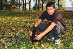 Fall boy and dog Stock Photo