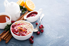 Fall breakfast with oatmeal and cranberry sauce stock image