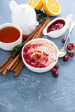 Fall breakfast with oatmeal and cranberry sauce royalty free stock photos