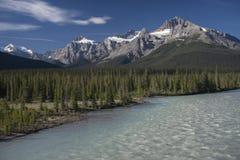Fall in Canadian Rockies. Deep blue skies and snowy peaks stock photo