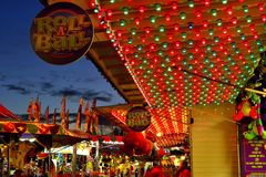 Fall Carnival. A travelling carnival provides entertainment and an array of color to the evening landscape Stock Image