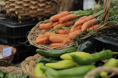 Fall Carrots at a Farmers Market. Fall carrots and vegetables being displayed at fall farmers market Stock Photos