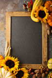 Fall chalkboard copy space with pumpkins and sunflowers Stock Photos