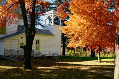 Fall in Church Yard. Indian Summer in a church yard in Minnesota, USA Stock Photo