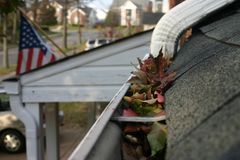 Fall Cleanup - Leaves in Gutter #2 Stock Photos