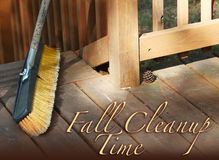 Fall Cleanup Time. Wooden deck with large broom and debris with pinecone and the text Fall Cleanup Time Stock Images