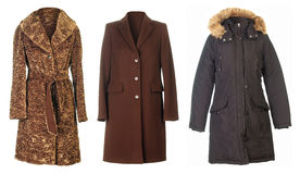 Fall coats. Three coats isolated on white background Stock Photo