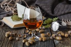 Fall cold weather time, relax with glass of alcohol Stock Photos
