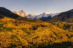 Fall color Capital Peaks, snowmass village, Colorado. Fall foliage color and big mountain with snow on top. Capital Peak, Snowmass Wilderness, Colorado Stock Photo