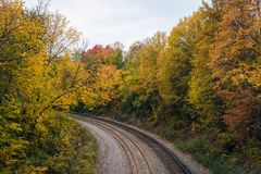 Fall color and railroad tracks in Remington, Baltimore, Maryland.  stock photo