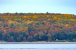 Fall Colors Across a Quiet Bay Royalty Free Stock Photography