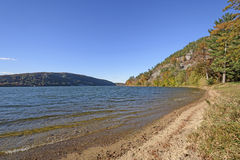 Fall Colors along a Quiet Lakeshore. In Devils Lake State Park in Wisconsin Royalty Free Stock Photo