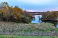 Fall colors along a small water connection between two lakes. Fall colors along a small water connection between two components of lake Zorinsky in Omaha stock photography