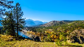 Fall colors along the Thompson River in BC Canada. Fall colors and colorful rocks along the Thompson River at White Canyon near Skihist Provincial Park along the royalty free stock photo
