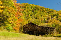 Fall colors around an old barn. Royalty Free Stock Photography