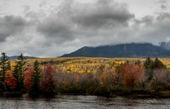 Fall Colors Blanket the Base of Mount Katahdin. Behind Penobscot river Royalty Free Stock Images