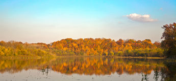 Fall colors on a calm lake stock photos