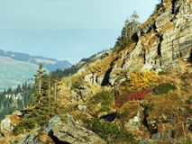 Fall colors on the Churfirsten mountain range, above Lake Walensee royalty free stock image