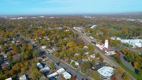 Fall colors and the city of Boise Idaho aerial view. Panning to the right of Boise in Fall of the magnificent train depot stock video