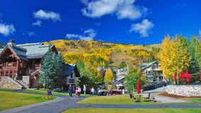Fall colors in the Colorado mountains. AVON, CO - SEPTEMBER 25, 2016: Families soak in the fall colors at Beaver Creek Resort in Colorado royalty free stock photo