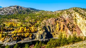 Fall colors along the Thompson River in BC Canada. Fall colors and colorful rocks along the Thompson River at White Canyon near Skihist Provincial Park along the royalty free stock photography