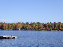 Fall colors in cottage country. Lake with autumn leaves and dock stock photos