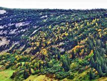 Fall colors in forests of Alpstein mountain range and Thur River valley. Canton St. Gallen, Switzerland stock photo