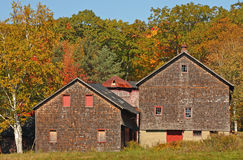 Fall colors on hillside  with old barn Royalty Free Stock Photos