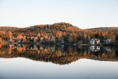 Fall colors of houses on the Lake and Mountain Royalty Free Stock Image
