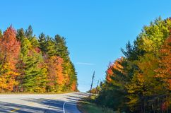 Fall colors on a lonely stretch of highway Stock Photos
