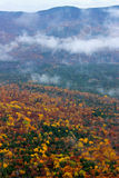Fall Colors on a Misty Day. A view from the Welch-Dickey hiking trail in the White Mountains of New Hampshire on a misty day in Fall Stock Photography