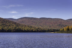 Fall colors with mountains and a lake Royalty Free Stock Photos