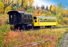 Fall colors of New Hampshire with Train. Beautiful fall colors of New England United States stock photo