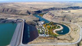 Aerial view of Lucky Peak Dam in the Fall Boise River. Fall colors in a park at the base of an Idaho Dam on the Boise River stock photos