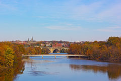 Fall colors of Potomac riverside and Key Bridge, Washington DC. Royalty Free Stock Photography