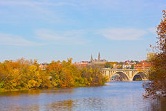 Fall colors of Potomac riverside and Key Bridge, Washington DC. Royalty Free Stock Photo