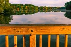 Fall colors reflect on lake pond Stock Image