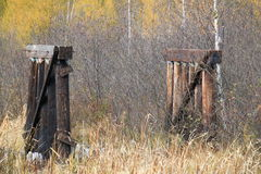 Wisconsin's autumn is a backdrop for these ruins of an old bridge royalty free stock image