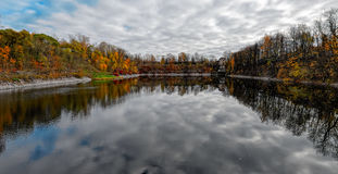Fall colors reflecting on a pond Royalty Free Stock Images