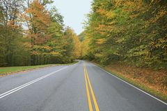 Fall colors on the road Royalty Free Stock Photography