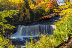 Fall colors at Tahquamenon Falls in Michigan. Tahquamenon Falls in Michigan's eastern Upper Peninsula seen with colorful fall foliage. This beautiful waterfall