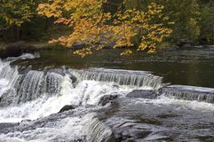 Fall Colors, Waterfall, Scenic Landscape. Waterfall in upper Michigan during the autumn with the fall colors stock image