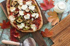 Fall comfort food. Homemade vegetarian pizza with eggplants, pep royalty free stock image
