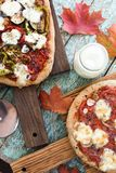 Fall comfort food. Tasty rustic pizzas with eggplants, peppers, royalty free stock photography