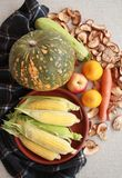 Fall composition for thanksgiving day with corn,apple,mushrooms and pumpkin. Fall composition for thanksgiving day with corn,apple,mushrooms and pumpkin royalty free stock photos